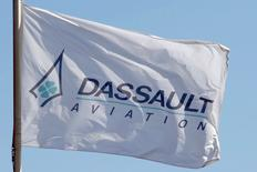 A flag with the logo of French aircraft manufacturer Dassault Aviation flies at the entrance of the company's factory in Merignac near Bordeaux during a visit by the French President March 4, 2015.   REUTERS/Regis Duvignau