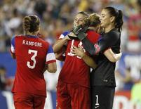 Jun 14, 2014; Tampa, FL, USA; United States goalkeeper Hope Solo (1), defender Ali Krieger (11), midfielder Allie Long (15) and defender Christie Rampone (3) celebrate after they beat France in a women's soccer friendly at Raymond James Stadium. United States defeated France 1-0. Mandatory Credit: Kim Klement-USA TODAY Sports
