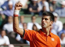 Novak Djokovic of Serbia reacts during his men's quarter-final match against Rafael Nadal of Spain during the French Open tennis tournament at the Roland Garros stadium in Paris, France, June 3, 2015.       REUTERS/Jean-Paul Pelissier