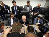 Iran's Oil Minister Bijan Zangeneh (C) talks to journalists before a meeting of OPEC oil ministers in Vienna, Austria, June 5, 2015. REUTERS/Heinz-Peter Bader
