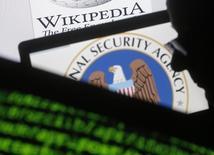 Fotografia ilustrativa de códigos e o logo da Agência Nacional de Segurança dos EUA.    11/03/2015   REUTERS/Dado Ruvic