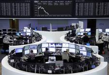 Traders work at their screens in front of the German share price index DAX board at the stock exchange in Frankfurt, Germany June 9, 2015.       REUTERS/Stringer