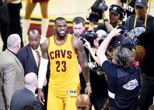 Jun 9, 2015; Cleveland, OH, USA; Cleveland Cavaliers forward LeBron James (23) reacts after winning game three of the NBA Finals against the Golden State Warriors at Quicken Loans Arena. Cleveland won 96-91. Mandatory Credit: David Richard-USA TODAY Sports
