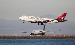 A Virgin Atlantic Boeing 747-400 lands as a United Airlines Boeing 767 taxis at San Francisco International Airport, San Francisco, California, February 13, 2015. REUTERS/Louis Nastro