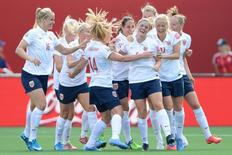 Jun 11, 2015; Ottawa, Ontario, CAN; Norway midfielder Maren Mjelde (6) is congratulated by teammates after scoring a goal against Germany on a free kick in the second half of a Group B soccer match in the 2015 FIFA women's World Cup at Lansdowne Stadium. Mandatory Credit: Marc DesRosiers-USA TODAY Sports