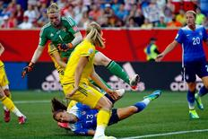 Jun 12, 2015; Winnipeg, Manitoba, CAN; United States forward Alex Morgan (13) falls after colliding with Sweden goalkeeper Hedvig Lindahl (1) during the second half in a Group D soccer match in the 2015 FIFA women's World Cup at Winnipeg Stadium. The game ended in a draw 0-0.  Mandatory Credit: Michael Chow-USA TODAY Sports