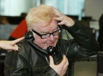 Radio presenter Chris Evans takes part in a trade on the trading floor of BGC Partners in London September 11, 2013. REUTERS/Stefan Wermuth
