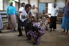 Instructors from the Ujamaa self-defence programme train a group of women to protect themselves against rape at the Mukuru Kwa Njenga slum in the capital Nairobi, Kenya, March 16, 2015. Across Nairobi, more than 200 elderly women, aged up to 105, are learning self defence to protect themselves against rape, which is widespread in Kenya, particularly in its slums.  REUTERS/Siegfried Modola