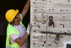 A worker inspects a door of the 14th-century Othello Tower in Famagusta, Cyprus, June 17, 2015.  REUTERS/Yiannis Kourtoglou