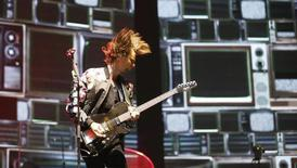 Lead vocalist Matthew Bellamy of Muse performs at the Coachella Valley Music and Arts Festival in Indio, California April 12, 2014. Picture taken April 12, 2014.   REUTERS/Mario Anzuoni