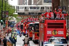 Jun 18, 2015; Chicago, IL, USA; The Chicago Blackhawks parade makes its way east on Monroe during the 2015 Stanley Cup championship parade and rally at Soldier Field. Mandatory Credit: Jon Durr-USA TODAY Sports
