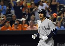 Jun 13, 2015; Baltimore, MD, USA; New York Yankees designated hitter Alex Rodriguez (13) reacts as he runs down the third base line after hitting a two run home run for rbi 2001 of his career during the sixth inning against the Baltimore Orioles at  Oriole Park at Camden Yards. Mandatory Credit: Tommy Gilligan-USA TODAY Sports