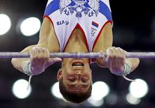 Nikita Ignatyev of Russia performs during the men's gymnastics horizontal bar final at the 1st European Games in Baku, Azerbaijan, June 20 , 2015. REUTERS/Kai Pfaffenbach