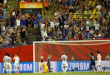 June 21, 2015; Montreal, Quebec, CAN; Fans react following the goal scored by France forward Marie Laure (not pictured) against Korea Republic during the second half in the round of sixteen in the FIFA 2015 women's World Cup soccer tournament at Olympic Stadium. Mandatory Credit: Jean-Yves Ahern-USA TODAY Sports