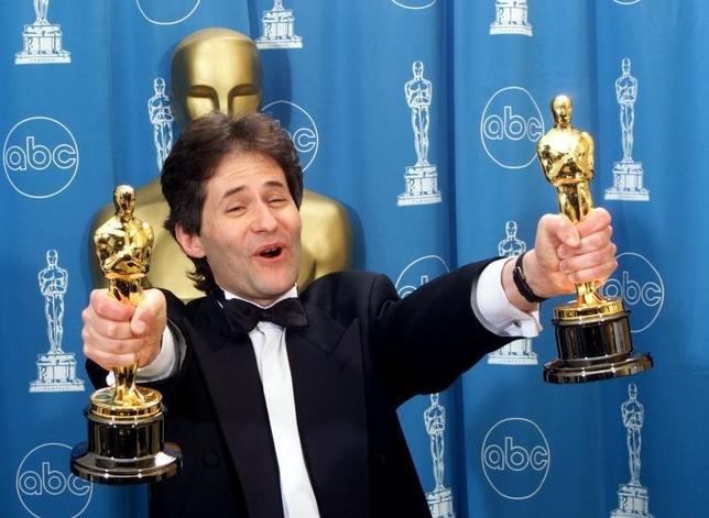 James Horner holds up two Oscars after winning for Best Original Song and Original Dramatic Score for his work on the movie ''Titanic'' March 23 at the 70th Annual Academy Awards. The movie ''Titanic'' was nominated for 14 Academy Awards.