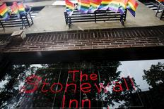 A neon sign shines in the window of the Stonewall Inn in New York, June 23, 2015. REUTERS/Lucas Jackson