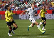 Jun 22, 2015; Edmonton, Alberta, CAN; United States forward Abby Wambach (20) runs down a  ball in the box against Colombia defender Angela Clavijo (13) during the first half in the round of sixteen in the FIFA 2015 women's World Cup soccer tournament at Commonwealth Stadium. Mandatory Credit: Michael Chow-USA TODAY Sports