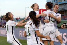 Jun 26, 2015; Ottawa, Ontario, CAN; United States midfielder Carli Lloyd (10) celebrates her goal with teammates against China during the second half in the quarterfinals of the FIFA 2015 Women's World Cup at Lansdowne Stadium. Mandatory Credit: Marc DesRosiers-USA TODAY Sports