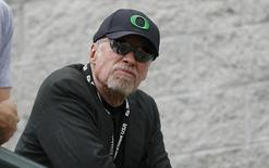 Phil Knight, co-founder and chairman of NIKE, Inc. watches the U.S. Olympic athletics trials in Eugene, Oregon June 29, 2012. REUTERS/Steve Dipaola