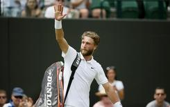Liam Broady of Britain waves to the crowd after losing his match against David Goffin of Belgium at the Wimbledon Tennis Championships in London, July 1, 2015.  REUTERS/Stefan Wermuth