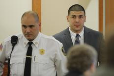 Former New England Patriots football player Aaron Hernandez arrives in the courtroom at Bristol County Superior Court in Fall River, Massachusetts April 1, 2015.  REUTERS/Brian Snyder