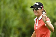 Gwladys Nocera of France waves to the crowd on the 5th hole during the third round of the Evian Masters golf tournament July 24, 2010.   REUTERS/Valentin Flauraud