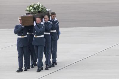 Tunisia victims' bodies arrive in Britain