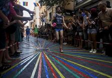 Contestants take part in the annual high heels race during Gay Pride celebrations in Chueca quarter in Madrid, Spain, July 2, 2015. REUTERS/Sergio Perez