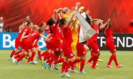 England celebrates their victory over Germany in the third place match of the FIFA 2015 Women's World Cup at Commonwealth Stadium. England defeated Germany 1-0 in extra time. Mandatory Credit: Erich Schlegel-USA TODAY Sports