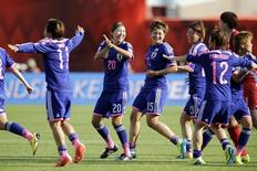 Japan celebrates after beating England in the semifinals of the FIFA 2015 Women's World Cup at Commonwealth Stadium.  Erich Schlegel-USA TODAY Sports