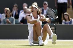 Garbine Muguruza of Spain celebrates after winning her match against Timea Bacsinszky of Switzerland at the Wimbledon Tennis Championships in London, July 7, 2015. REUTERS/Henry Browne