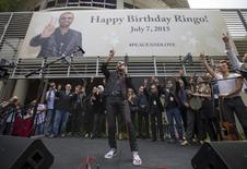 """Musician Ringo Starr speaks during a """"Peace & Love"""" event to celebrate Starr's 75th birthday in Los Angeles, California, July 7, 2015. REUTERS/Mario Anzuoni"""