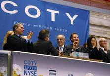 Michele Scannavini, (C) CEO of Coty Inc., and company representatives ring the opening bell at the New York Stock Exchange to celebrate the company's IPO, June 13, 2013. Shares of perfume and beauty products seller Coty Inc fell in their market debut on Thursday, taking the gloss off the third-largest U.S. IPO this year. REUTERS/Brendan McDermid (UNITED STATES - Tags: BUSINESS)
