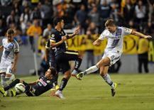 Los Angeles, CA, USA; Los Angeles Galaxy midfielder Steven Gerrard (8) clears the ball against Club America during the first half at Stubhub Center.  Gary A. Vasquez-USA TODAY Sports
