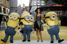 "Actress Sandra Bullock poses with characters in costume from the film during the ""Minions"" World Premiere at Leicester Square in London, Britain  June 11, 2015. REUTERS/Luke MacGregor"