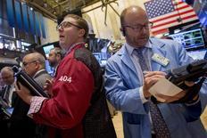 Traders work on the floor of the New York Stock Exchange July 16, 2015. REUTERS/Brendan McDermid