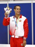 Jul 14, 2015; Toronto, Ontario, CAN; Mauricio Fiol of Peru celebrates after placing second in the men's 200m butterfly swimming final during the 2015 Pan Am Games at Pan Am Aquatics UTS Centre and Field House. Mandatory Credit: Rob Schumacher-USA TODAY Sports