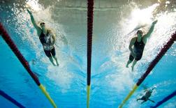 Caitlin Leverenz of the United States (right) races Emily Overholt of Canada (left) in the women's swimming 400m individual medley final during the 2015 Pan Am Games at Pan Am Aquatics UTS Centre and Field House. Erich Schlegel-USA TODAY Sports