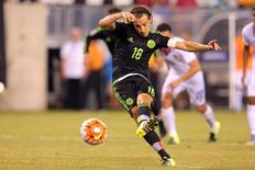 Jul 19, 2015; East Rutherford, NJ, USA; Mexico midfielder Andres Guardado (18) kicks a penalty kick to score a goal against Costa Rica during stoppage time of the overtime period of a CONCACAF Gold Cup quarterfinal match at MetLife Stadium. Mexico won 1-0 in overtime. Mandatory Credit: Brad Penner-USA TODAY Sports
