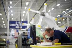 Aircraft technicians assemble S-92A helicopters at Sikorsky Global Helicopters in Coatesville, Pennsylvania October 16, 2014.    REUTERS/Mark Makela