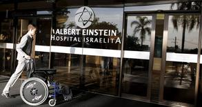 A man pushes a wheelchair at the entrance of Albert Einstein Hospital, where Brazilian soccer legend Pele was hospitalized since last week in Sao Paulo July 20, 2015.  REUTERS/Nacho Doce