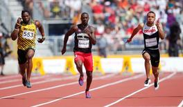 From left Jason Livermore of Jamaica , Daniel Bailey of Antigua and Andre De Grasse of Canada race in a men's athletics 100m preliminary heat during the 2015 Pan Am Games at CIBC Pan Am Athletics Stadium. Mandatory Credit: Erich Schlegel-USA TODAY Sports