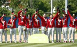 Canada players celebrate after receiving their silver medals after the women's baseball gold medal match during the 2015 Pan Am Games at Ajax Pan Am Ballpark. Mandatory Credit: Rob Schumacher-USA TODAY Sports