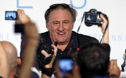 """Journalists take pictures as cast member Gerard Depardieu arrives to attend a news conference for the film """"Valley of Love"""" in competition at the 68th Cannes Film Festival in Cannes, southern France, May 22, 2015.    REUTERS/Eric Gaillard"""