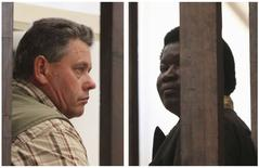A combination photo shows Zimbabwean safari operator Honest Ndlovu (R) and fellow countryman and hunter Theo Bronkhorst waiting to appear in Hwange magistrates court, July 29, 2015. REUTERS/Philimon Bulawayo
