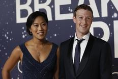 Mark Zuckerberg (R), founder and CEO of Facebook, and wife Priscilla Chan arrive on the red carpet during the 2nd annual Breakthrough Prize Award in Mountain View, California November 9, 2014. REUTERS/Stephen Lam