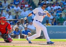 Aug 2, 2015; Los Angeles, CA, USA; Los Angeles Dodgers right fielder Andre Ethier (16) hits a walk off home run in the tenth inning of the game against the the Los Angeles Angels at Dodger Stadium. Dodgers won 5-3.  Jayne Kamin-Oncea-USA TODAY Sports