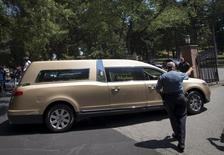 A hearse carrying the remains of Bobbi Kristina Brown arrives for a burial service at the Fairview Cemetery in Westfield, New Jersey, August 3, 2015.REUTERS/Mike Segar