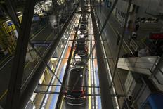 Production Associates inspect cars moving along assembly line at Honda manufacturing plant in Alliston, Ontario March 30, 2015.  REUTERS/Fred Thornhill    -
