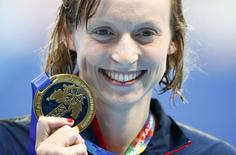 Katie Ledecky of the U.S. poses with her gold medal after the women's 200m freestyle final at the Aquatics World Championships in Kazan, Russia, August 5, 2015.              REUTERS/Hannibal Hanschke